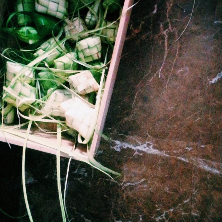 A box full of weaved Ketupat