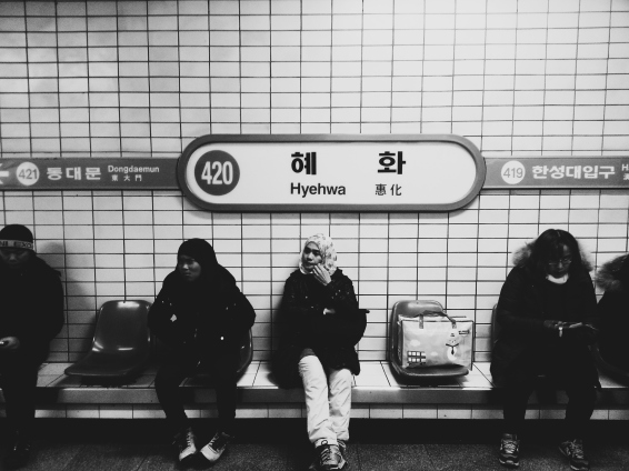 Commuters waiting for a train at Hyehwa Station