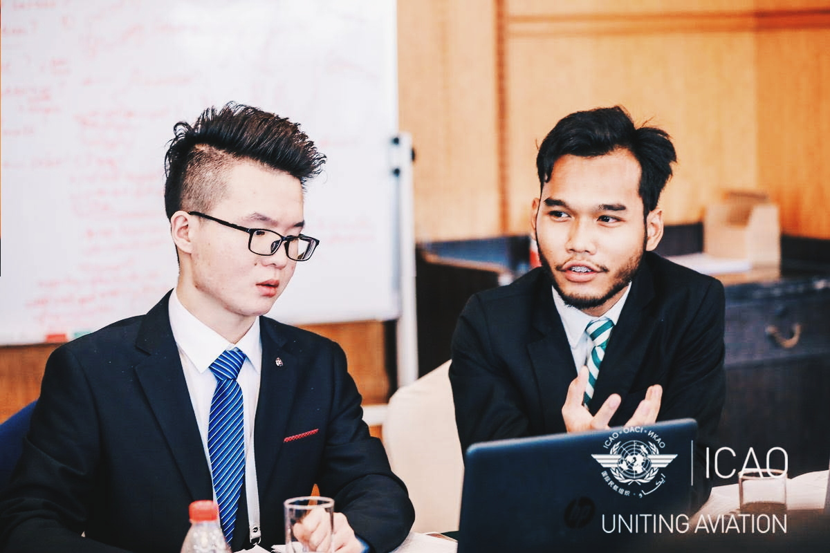 Danish Danial Bin Anuar engaged in a discussion at the 2nd Model ICAO Forum